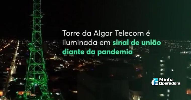 Torre da Algar Telecom iluminada na cor verde