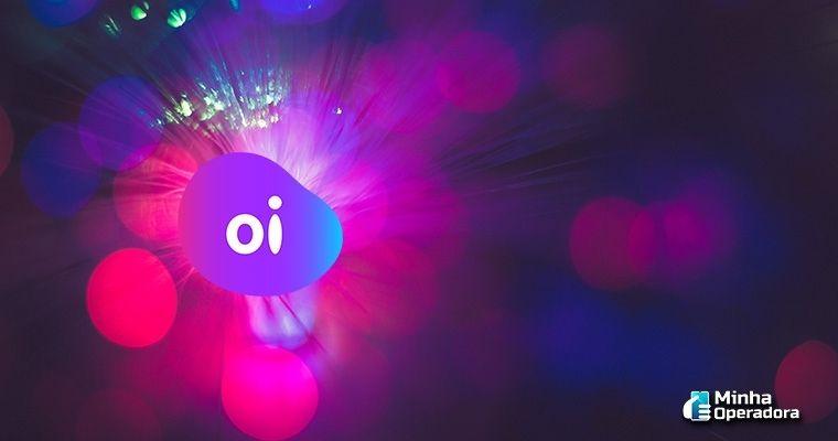 Logotipo da Oi Fibra em roxo.