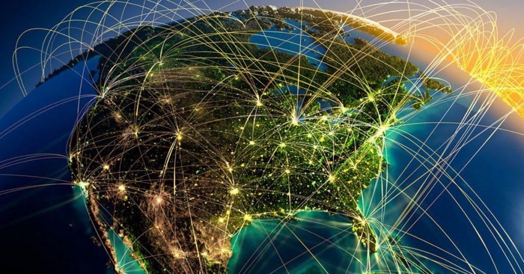 Globo terrestre recheado de conexões luminosas.
