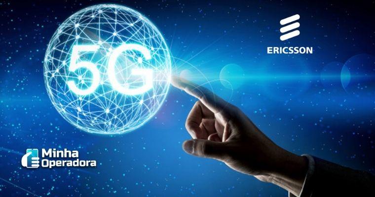 Dedo de uma pessoa tocando na palavra 5G que está flutuando em um fundo azul.