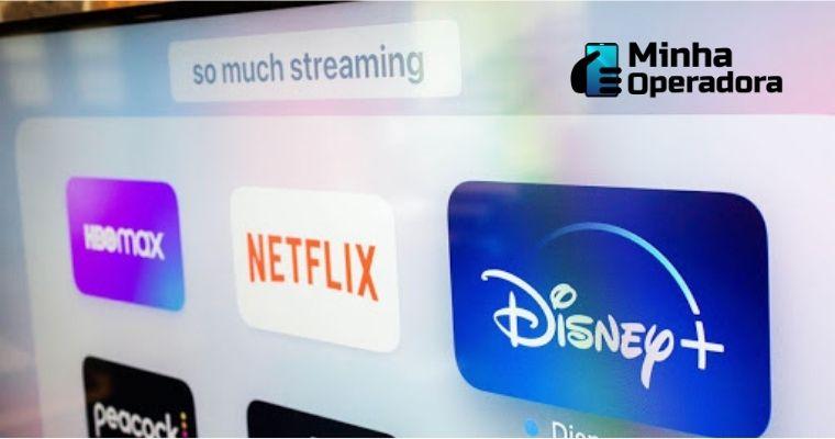 Logotipos do HBO Max, Netflix e Disney+ em uma tela.
